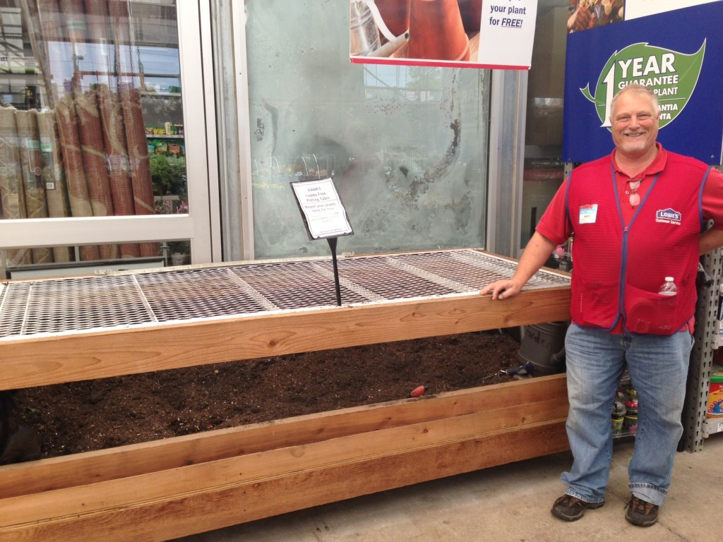 Lowe's offers station to repot your plants that you purchase at Lowe's!