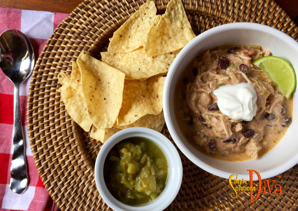 Serve This Chicken Enchilada Green Chili Soup with Tortilla Chips, cheese and sour cream!